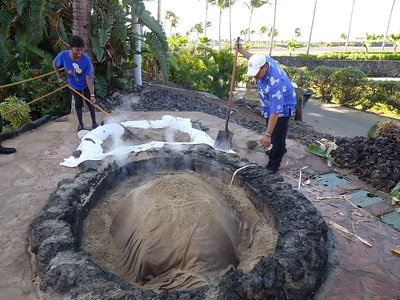 Finally, cover the whole thing with sand to keep the heat in. Cooks all day for the luau that night. YUM!