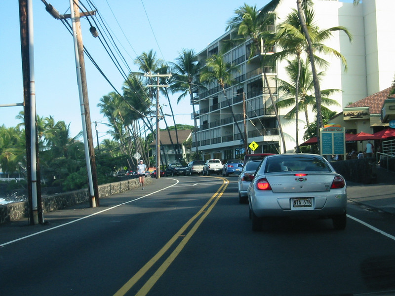 Kona traffic jam on Ali'i Drive. (2011 Tsunami from the Japan earthquake came over the wall and damaged the road and many of the businesses along the drive.)