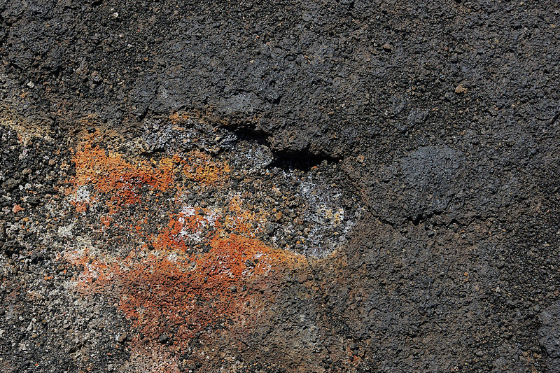 As various minerals ooze out of lava, they get oxidized exhibiting different colors.