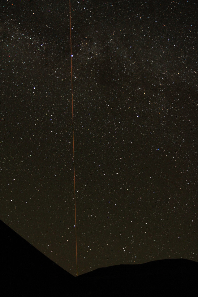Laser beam from one of the observatories on top of Mauna Kea.