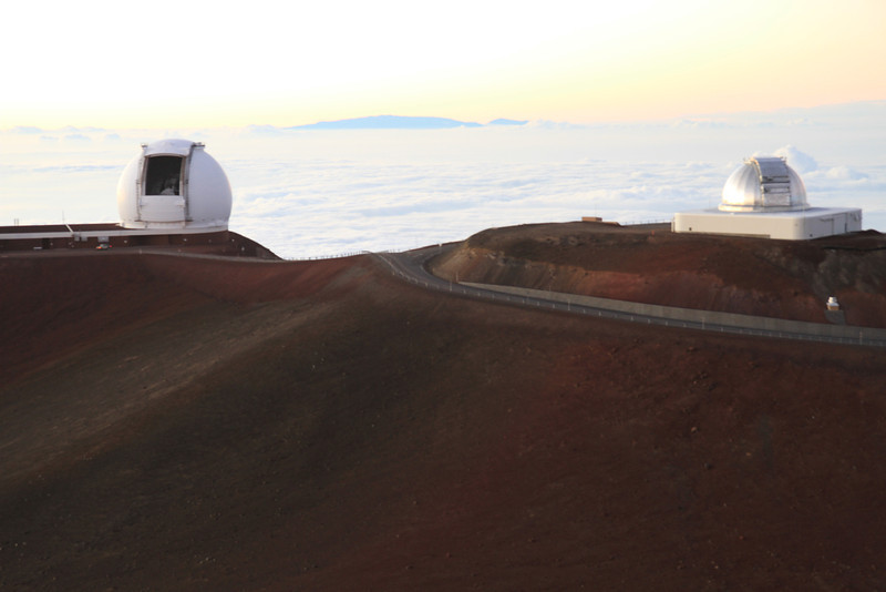 Observatories, sunset & Maui (Haleakala) poking through the clouds.