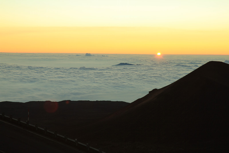 Sun setting into the clouds with Hualalai.