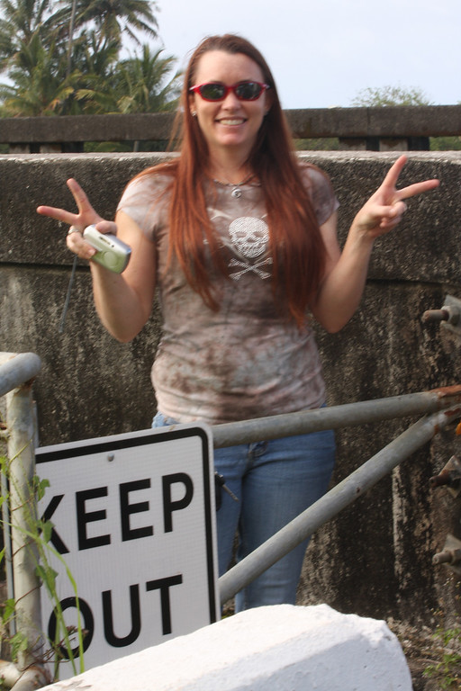 "Kendra. Please note the ""Keep Out"" sign and that she's flashing a gang symbol. She's trouble."