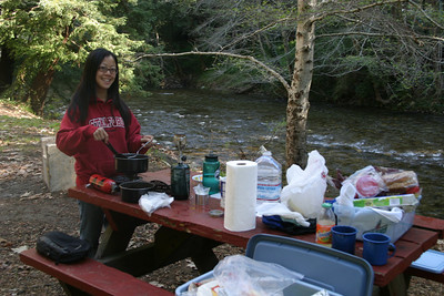 "The most important meal of the day: T2 scrambles eggs and boils ""cowboy coffee"" next to the Big Sur River our first morning."