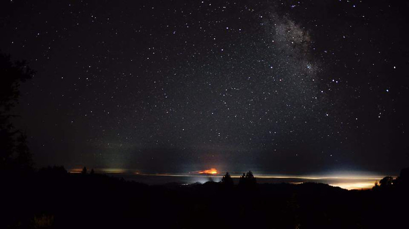 This is a view of the Sobranes fire in Big Sur taken off Summit Rd in the Santa Cruz Mts. on Agust 8, 2016.  The fire is quite some distance away but the glow is startling. The fire is center picture and the lights of Scotts Valley and Santa Cruz are on the lower right....Photo credit, Ryan Kalem