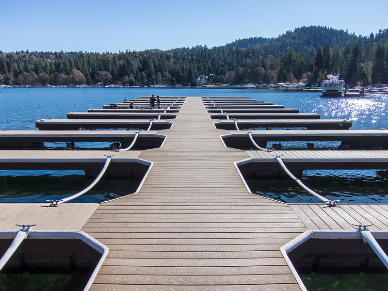 """<span id=""""title"""">Arrowhead Dock</span> On our way back home, we stopped by Lake Arrowhead, just because. There was a lot more emphasis on shopping there, so I'm glad we didn't stick around too long.  I imagine this dock is much more utilized in the summer. On this day, there was an empty canoe and these 3 guys in the distance - all other spots were empty.  Also, there were tons of ducks."""