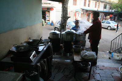 A typical restaurant in this part of China: basically a hole in the wall with no plumbing or electricity so they keeping the gas cookers out near the front of the shop and get water from communal taps. They usually had a few pots of broth or meat on the go so you walk up, point to the type of noodles you want and they dunk them in the broth to cook them in just a few minutes. Usually pretty good!