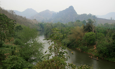 Scenes like this are why bike tourers love Laos (and why they are in denial about how painfully steep the roads are).