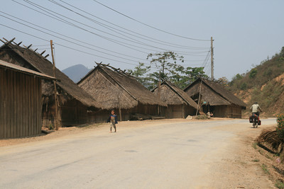 The hill people of Lao (the Hmong) live in different styles of houses than the rest of the country, and they perch their villages between the edges of the road and the near vertical hillsides. I even saw into one thatch house that had it's dirt floor crumbling out from under it down the hill.