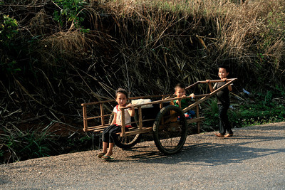 Late afternoon cycling is the best time to watch village life along the roads. In this town everyone was on their way to or from the water source, bathing and washing by the side of the road, or pushing jugs of water home.