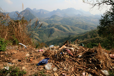 Landscape shot of northern Laos, trash included, because that's just how it is.