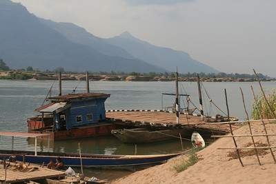 After the not-so-restful rest days in the 4,000 islands we headed north again, crossing the beautiful Mekong several times with our bikes on platform boats. This pretty crossing led us to an over-rated town and temple that weren't worth the 130km we did that day to see them. And to top it all off that night Adam mistakenly ordered me a banana pizza instead of a ham and pineapple pizza. Needless to say I was not impressed. In fact I don't think I've ever been as angry as I was that night in the whole bike trip.
