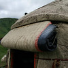 All yurt doors are a thick flap of felt that gets rolled up during the day.