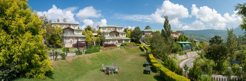 Panoramic view of Club Mahindra Binsar Valley Resort in the Kumaon Himalayan range. Binsar offers a breathtaking view of the snowy mountain ranges of Panchchuli, Shivling, Chaukhamba, Trishul and Nanda Devi.