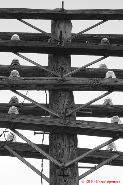 Black and White Photograph Old Electrical Insulators on Power Pole along Railroad Tracks in Birmingham, Alabama