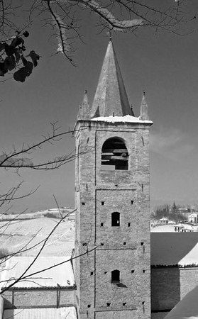 The old bell tower still stands over the castle town of Serralunga d'Alba - Italy