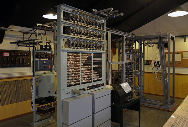 Tunny machine (nearer) and Heath Robinson replicas, National Museum of Computing, Bletchley Park, 29 December 2012.  The Tunny machines decyphered Lorenz messages after the Lorenz settings for the day had been ascertained, intially by the Heath Robinson, named for the cartoonist who specialised in improbable contraptions,  The Heath Robinsons entered service in June 1943.  They worked but were slow and unreliable.  From February 1944 they were superseded by the Colossus computers.