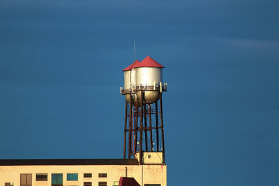 We scan the horizon.  Twin water towers are a landmark.