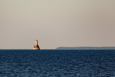 The distant Waugoshance Lighthouse