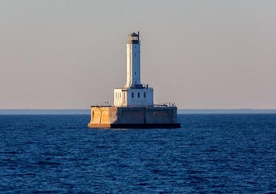 We pass Grays Reef Lighthouse at sundown, as we approach Mackinac Bridge.