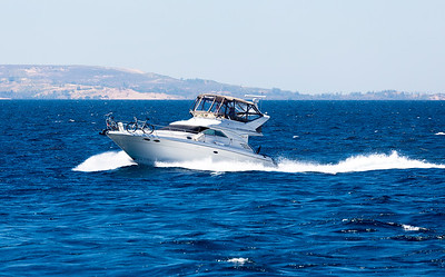 A pleasure craft makes it very clear that his boat is faster than our boat!