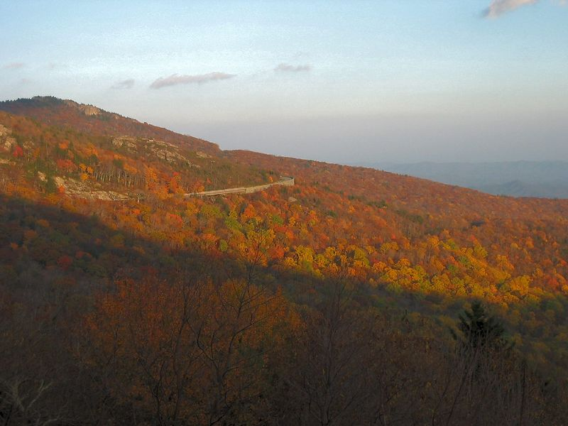 Setting sun over fall view, including ribbon of Blue Ridge Parkway, near Blowing Rock 2