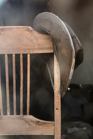 You can see the sweat on the brim of this old hat. After a hard day at the mines it gets to rest on this old chair