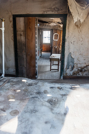 Looking across the old mattress into one of the rooms in this old home