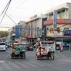 Downtown traffic and tricycle transport along the main road in Tagbilaran City, Bohol Island, Philippines.