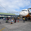 Passengers walk to board an aircraft at the airport in Tagbilaran City, Bohol Island, Philippines.