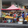 A sidewalk fruit vendor stall along the main road in downtown Tagbilaran City, Bohol Island, Philippines.