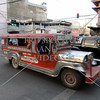Downtown traffic and jeepney transport along the main road in Tagbilaran City, Bohol Island, Philippines.
