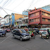 Downtown traffic and vehicle transports along the main road in Tagbilaran City, Bohol Island, Philippines.