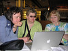 Marilou Bade, Jeannie Haukaas, and staff member Audrey Riley enjoy the photos in this photo album!