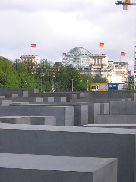 The Holocaust Memorial, foreground; the Reichstag, background. Berlin.