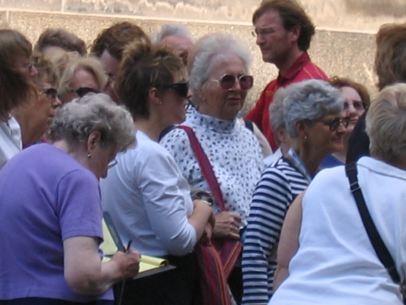 Participants listened attentively during a walking tour of Dresden on Wednesday, the 25th.