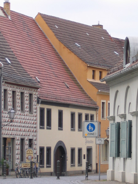 "Color is slowly returning to Torgau. Notice the quilt-like pattern on the shop on the left. One guide told us yesterday that so much of eastern Germany was gray during the days dominated by the GDR, ""just as our hearts were gray."""