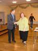 The Lord Mayor of Grimma and Linda Post Bushkofsky shake hands following a presentation about the town.