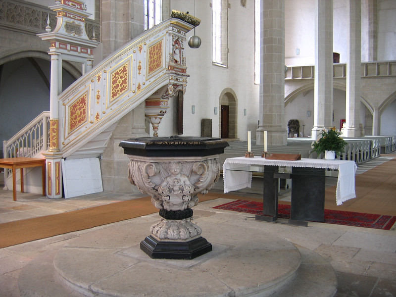 Taken within the chancel at St. Mary's, you see the font, free-standing altar and the pulpit.