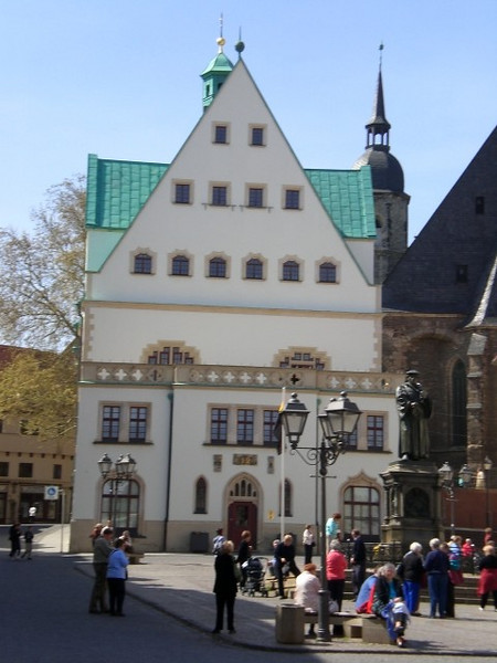 Gathering in the square in Eisleben, where Luther was born and baptized. His statue stands in front of the town hall.