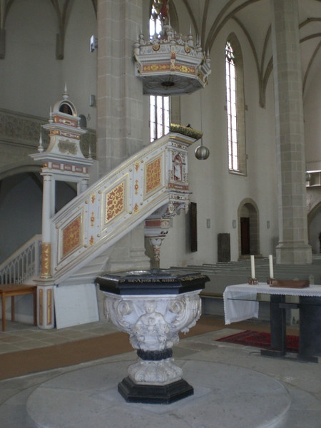 The pulpit and font in St. Mary's Church where Katie von Bora Luther is buried.