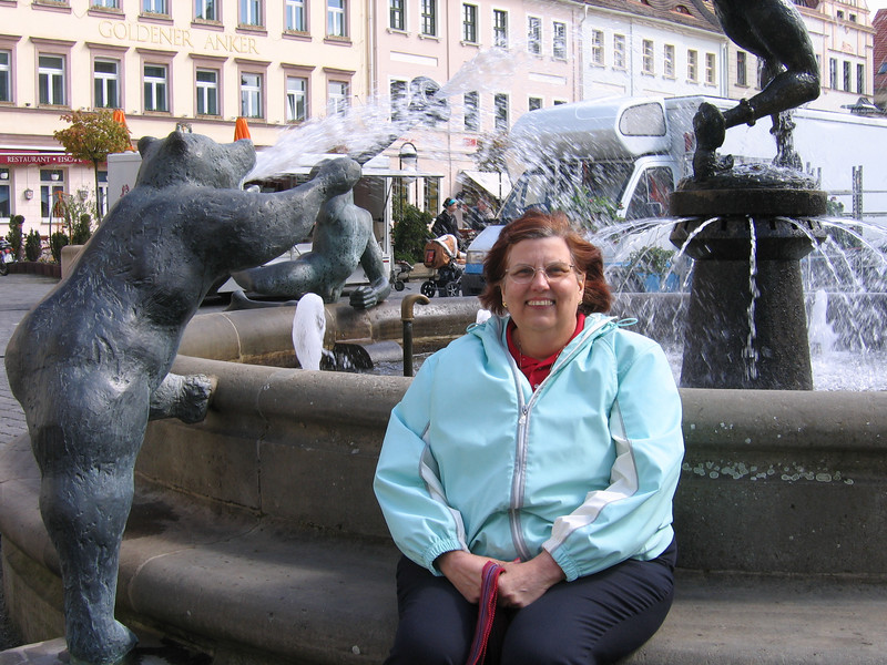 Kathy Schnierle, churchwide secretary of Women of the ELCA, enjoys a break at the fountain in the market square of Torgau.