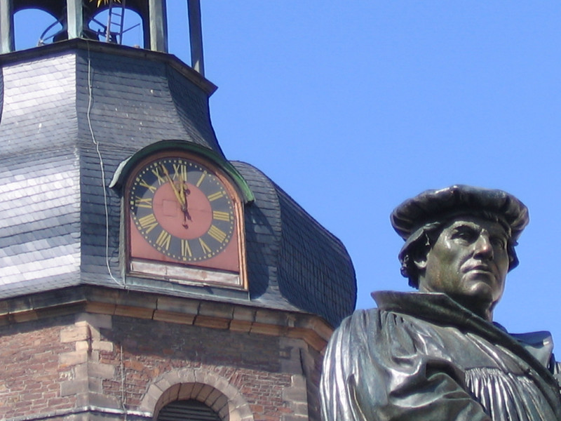 Taken in Eisleben: the clock tower of St. Andrew's church where Luther preached his final sermon and in the foreground, the Luther statute in the market square.