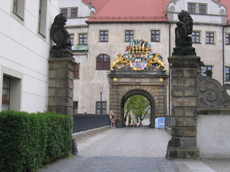 Two lions guard the initial entrance to the castle in Torgau.