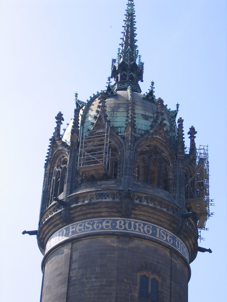 The tower of the Castle Church with M. Luther's famous phrase, a mighty fortress is our God.