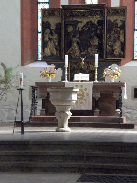 The altar and font of the Frauenkirche (Church of Our Lady) in Grimma.