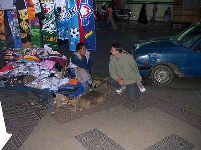 Shane's talking to someone selling her wares.