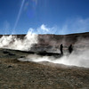 People lurking around, wandering between the geysers, fumaroles and mudpots at Geyser Sol de Mañana