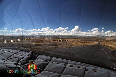 My view next to JoseLuiz.  The Cordillera Real range of mountains as seen from the Alti Plano. Returning to La Paz from Tiwanaku.  July 5, 2012
