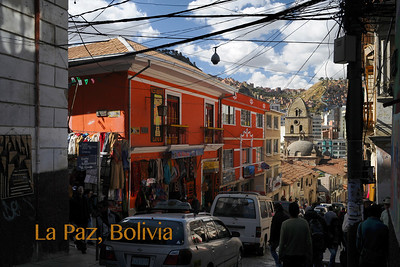 View down Calle Sagárnaga, a shopping street for native Bolivian gifts and clothing, to Iglesia San Francisco.